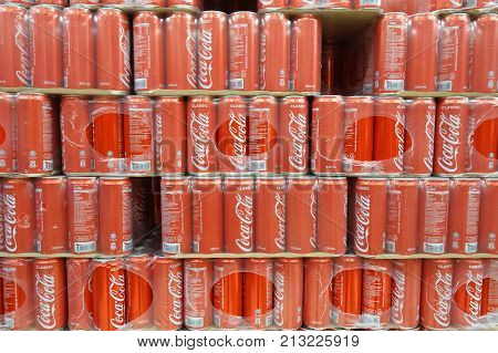 Grocery Store Shelf With Cans Of Coca Cola Classical