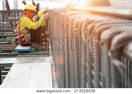 Construction workers fabricating steel reinforcement bar at the construction site