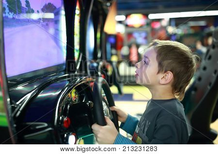 Child Playing In Car Simulator