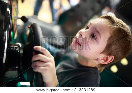 Happy Child Playing In Car Simulator
