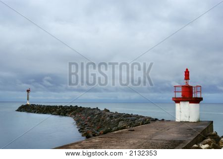 Lighthouse At The Jetty