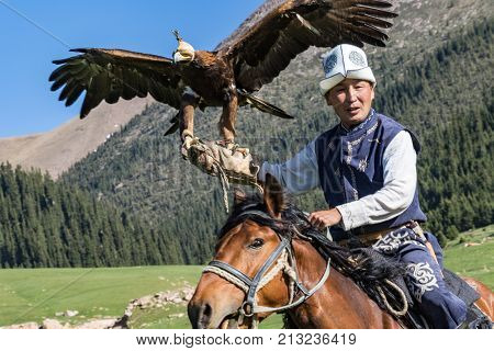 Eagle Hunter Holds His Eagles On Horseback, Ready To Take Flight