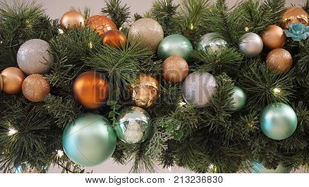Faux lit Christmas tree branch style decoration with balls and flowers
