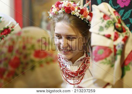 Belarus Gomel Folk Museum 26.11.2016 year. Rite vintage wedding. The woman in scarf.Belarusian wedding ceremony. The Belarusian Bride.Ethnic wedding.Authentic bride