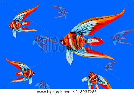 Colorful fish souvenir glass on blue background, closeup