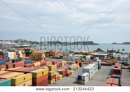 NOUMEA, NEW CALEDONIA, PACIFIC ISLANDS-NOVEMBER 25TH, 2016:  Elevated view over shipyard at commercial dock with Pacific Ocean views and nautical vessels on an overcast day in Noumea, New Caledonia.