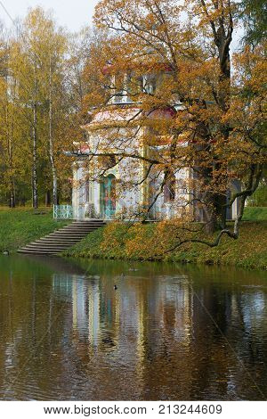 Screech (Chinese) gazebo in the autumn landscape. Tsarskoye Selo, Saint Petersburg