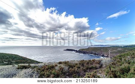 Panoramic View Of The Cliffs Of The Galician Atlantic Coast Near The City Of La Coruna. Blue Sky Wit