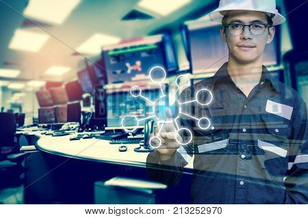 Double exposure of Engineer or Technician man with blank tool icons while pointing finger with monitor of computers room for oil and gas industrial business concept.
