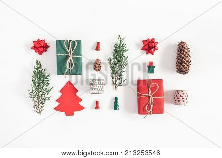Christmas composition. Christmas gifts pine branches toys on white background. Flat lay top view