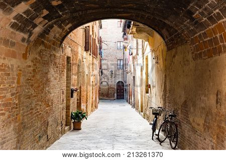 BUONCONVENTO ITALY - APRIL 3 2016 - View of a typical alley in Buonconvento : one of the 257 villages included in the list of