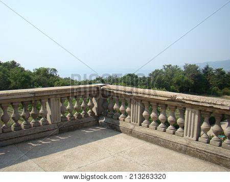 View through concrete balustrades to the sky. Photo.