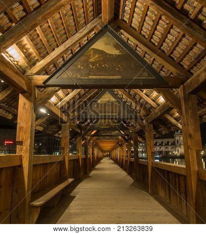 SWITZERLAND LUCERN - MARCH 19 2015: Inside view of Chapel Bridge in Lucern Switzerland