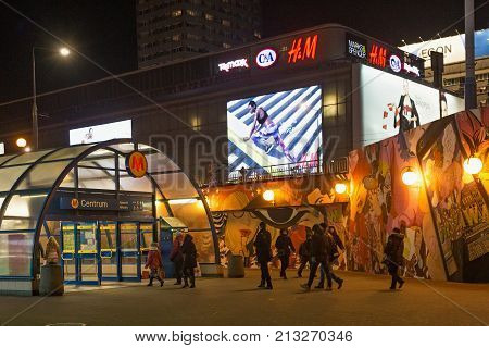 WARSAW, POLAND - JANUARY 02, 2016: Entrance to the metro station Centrum at winter night. Centrum is a station on Line M1 of the Warsaw Metro located under Plac Defilad a square in downtown.