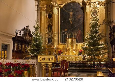 WARSAW, POLAND - JANUARY 02, 2016: Main altar of the Roman Catholic Church of the Holy Cross (XV-XVI cent.) in Christmas decorations. Is a one of the most notable Baroque churches in Poland's capital.