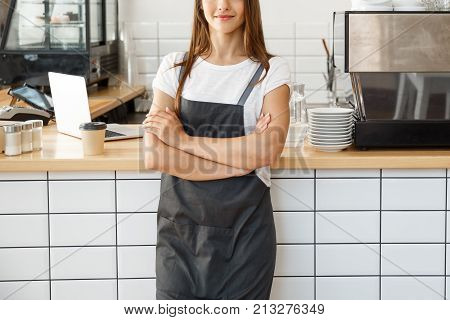 Coffee Business Owner Concept - Attractive Young Beautiful Caucasian Barista In Apron Smiling At Cam