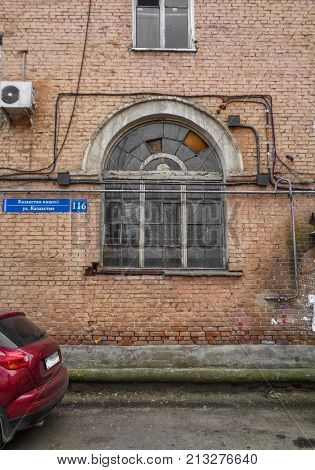 Kazakstan, Ust-Kamenogorsk, november 1, 2017: Arched window in an old residential building