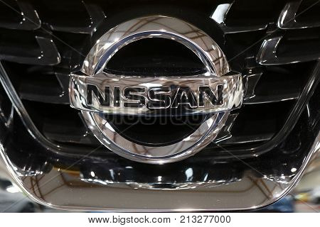 CRACOW POLAND - MAY 20 2017: Nissan metallic logo closeup on Nissan car displayed at MOTO SHOW in Cracow Poland. Exhibitors present most interesting aspects of the automotive industry