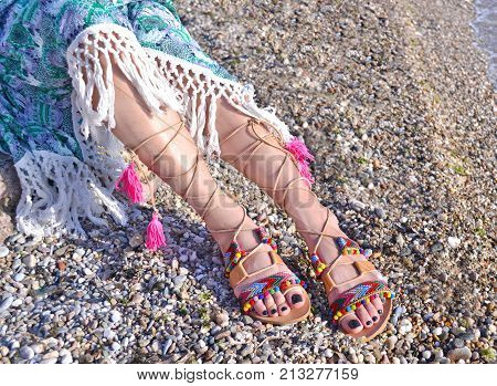 leather greek sandals advertisement on the beach - bohemian style clothing