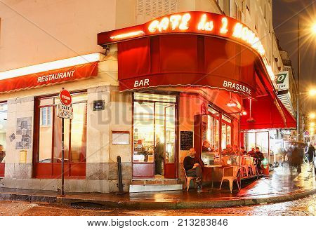 Paris, France, November 11, 2017: The Cafe des 2 Moulins French for Two Windmills is a traditional French cafe in the Montmartre district, Paris, France.