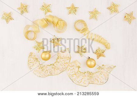 Face clowns of gold christmas decoration on soft white wood board top view. Christmas festive circus background.