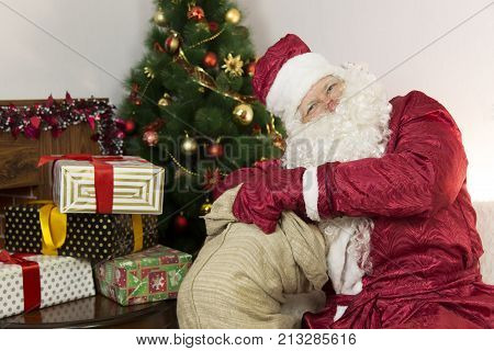 Santa Claus Gets Gifts From The Bag.