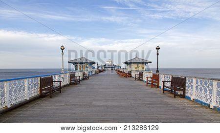 Llandudno, UK: March 15, 2014: Llandudno Pier is a Grade II* listed pier in the seaside resort of Llandudno, North Wales. At 2,295 feet, the pier is the longest in Wales