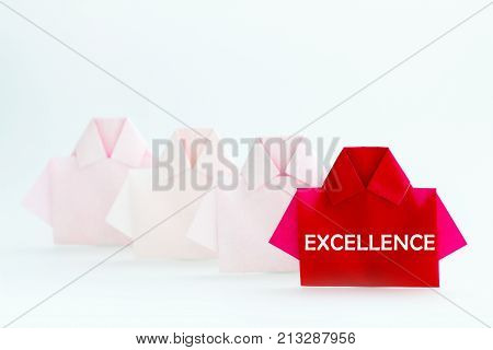 EXCELLENCE word on One Red among white origami shirt paper unique individuality and difference or leadership concept.