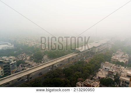 Smog over a metro station passing along a major road going through homes, offices and colonys. The poor air quality has been a concern in Delhi NCR