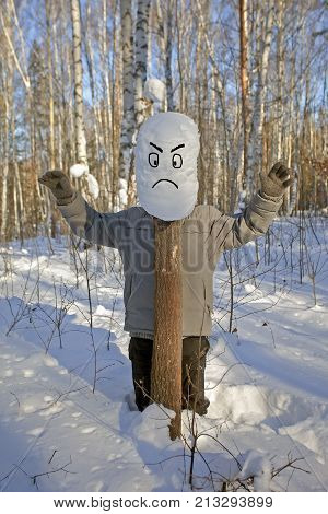 man winter in the woods a man stands in the snow near a stump covered with snow the man hid behind a stump