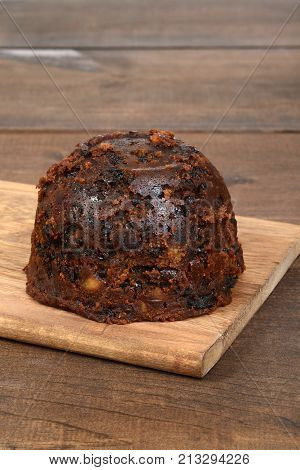 english christmas pudding on a wood cutting board