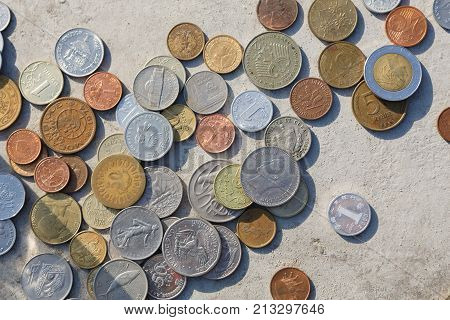 International coins mix fall out on floor, banking background copy space. Saving money, economic crisis and financial stability concept, top view