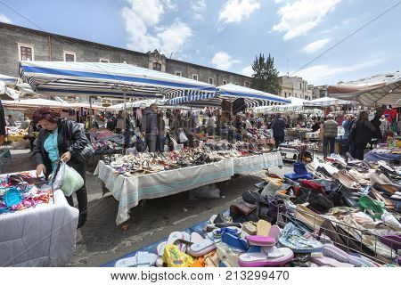CATANIA, ITALY. April 03, 2015: Second hand open air Sicilian market. Catania, Italy. Many people folk to the market during all daylight hours.