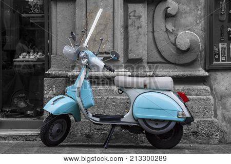 CATANIA, ITALY. April 3, 2015: Historic Italian motorcycle scooter. An ancient Italian water colored motorcycle is parked in front of a historic building in Catania, Sicily in Italy.