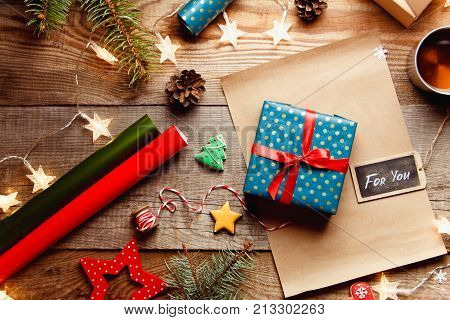 Beautiful Christmas Background With A New Year Décor, A Sheet Of Old Paper, Garland And Gifts, Ginge