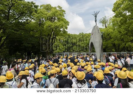 Hiroshima, Japan - May 25, 2017: Students gathering at the Children's Peace Monument in Hiroshima Peace Memorial Park in memory of atomic bombing victims