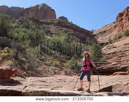 SEDONA, ARIZONA, OCTOBER 11. The Templeton Trail on October 11, 2017, near Sedona, Arizona. A Woman Hikes the Templeton Trail Down from Famous Cathedral Rock Near Sedona in Arizona.