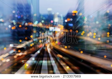 Fast moving train track with blurred bokeh city light night view abstract background
