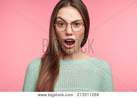 Perplexed Indignant Female With Asian Appearance, Keeps Mouth Opened, Raises Eyebrows, Opens Mouth,