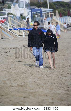 MALIBU, CA - AUG 26: Brian Grazer; his daughter on the beach in Malibu, California on August 26, 2007