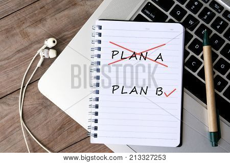Plan A And Plan B On Notepad On Top Of Laptop Keyboard