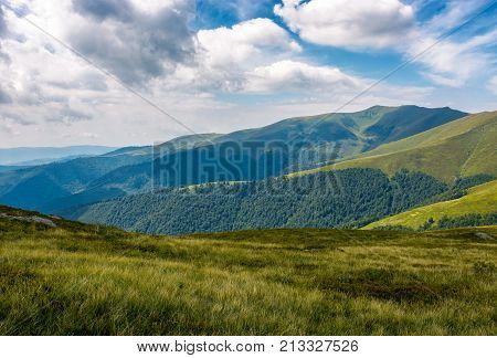 Grassy Slopes Under The Cloudy Sky