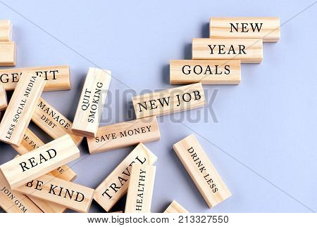 New Year Goals Concept - Scattered Wood Block with Resolutions Words