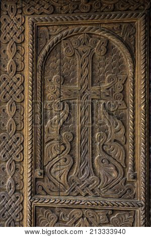 Decorative wooden door to the church of Saint Hripsime in Etchmiadzin Armenia.