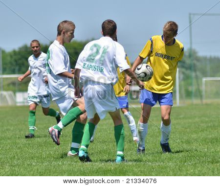 KAPOSVAR, HUNGARY - JUNE 11: Martin Torzsok (21) in action at the Hungarian National Championship under 17 game between Kaposvari Rakoczi FC and Bajai LSE on June 11, 2011 in Kaposvar, Hungary.