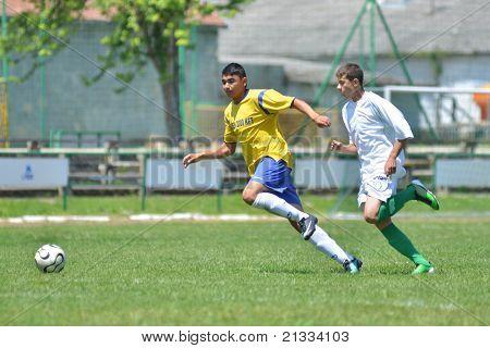 KAPOSVAR, HUNGARY - JUNE 11: Richard Csaki (in white) in action at the Hungarian National Championship under 17 game between Kaposvari Rakoczi FC and Bajai LSE on June 11, 2011 in Kaposvar, Hungary.