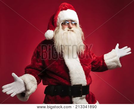 happy santa claus welcoming you on red background