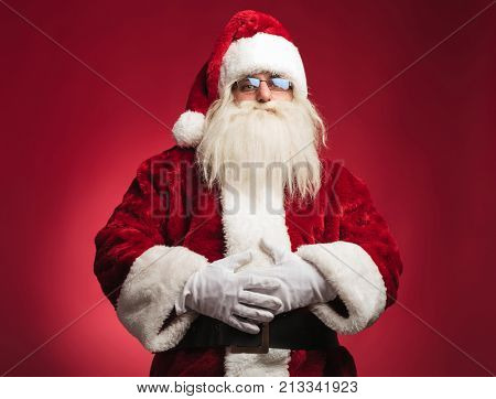 santa claus with full belly standing on red background
