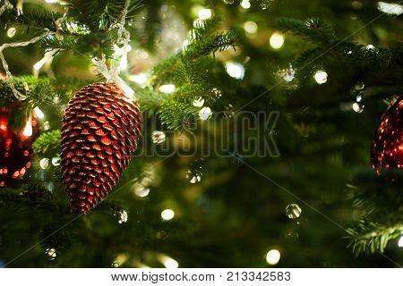 Decorated and illuminated Christmas tree. Christmas ball close-up. Holiday concept, winter season