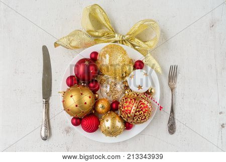 Christmas dinner - white plate with decorations and knife and fork